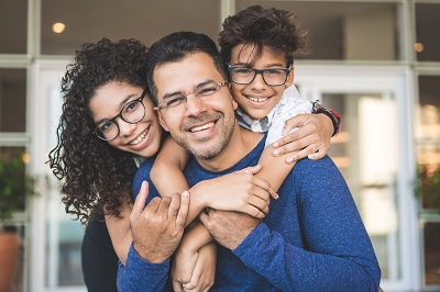 Chicago family wearing eyeglasses covered by Cigna vision insurance