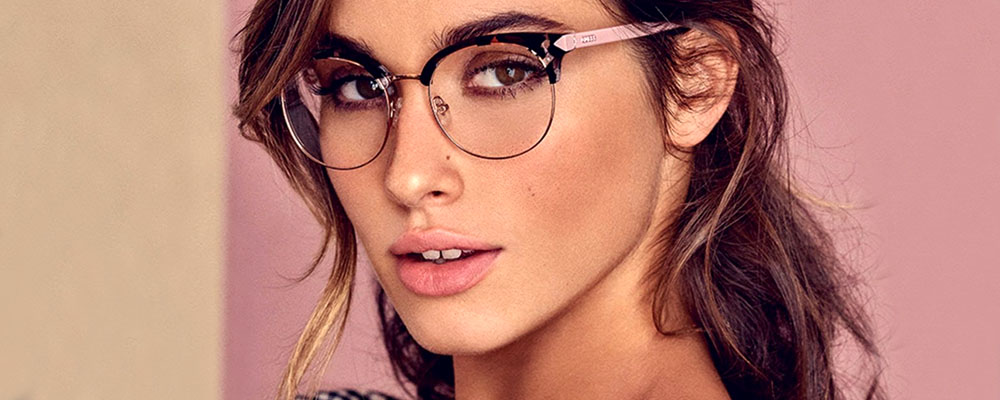 Woman wearing GUESS glasses
