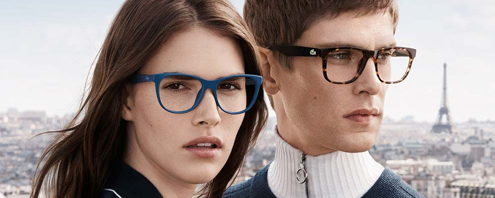 Two people wearing Lacoste glasses