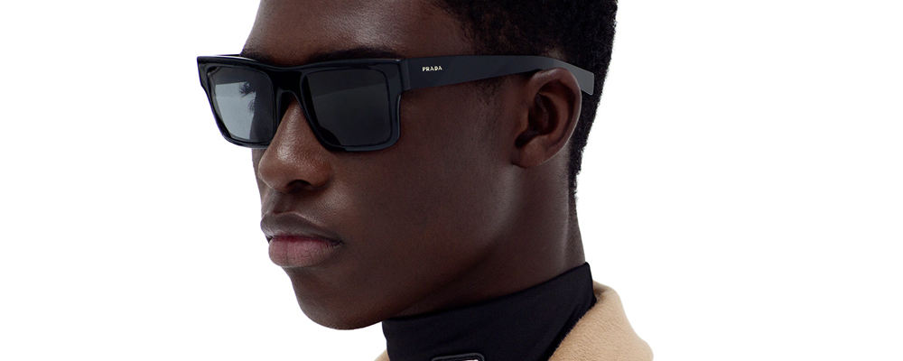 Man wearing Prada sunglasses