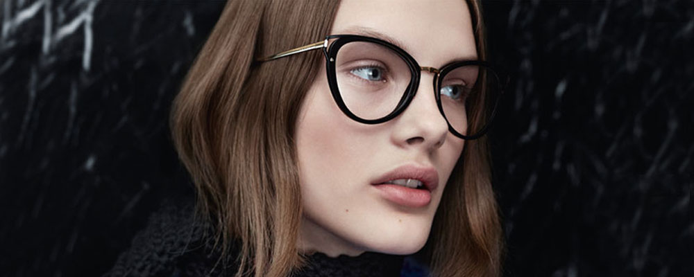 Woman wearing Prada glasses