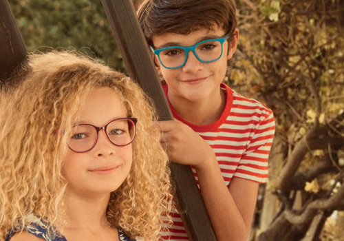 Designer kids' eyeglass frames and impact-resistant lenses